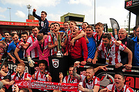 Lincoln City players lift the National League trophy<br /> <br /> Photographer Andrew Vaughan/CameraSport<br /> <br /> Vanarama National League - Lincoln City v Macclesfield Town - Saturday 22nd April 2017 - Sincil Bank - Lincoln<br /> <br /> World Copyright &copy; 2017 CameraSport. All rights reserved. 43 Linden Ave. Countesthorpe. Leicester. England. LE8 5PG - Tel: +44 (0) 116 277 4147 - admin@camerasport.com - www.camerasport.com