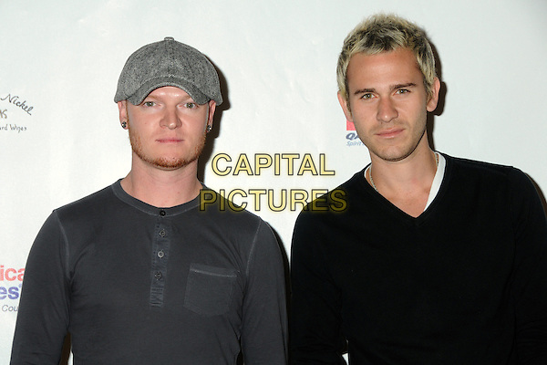 "RICK WOOLSTENHULME JR. & JASON WADE of Lifehouse .UCLA Jonsson Cancer Center's 15th Annual ""Taste For A Cure"" held at the Beverly Wilshire Hotel, Beverly Hills, California, USA, 30th April 2010..portrait headshot grey gray earrings cap hat black beard facial hair jumper sweater top .CAP/ADM/BP.©Byron Purvis/AdMedia/Capital Pictures."