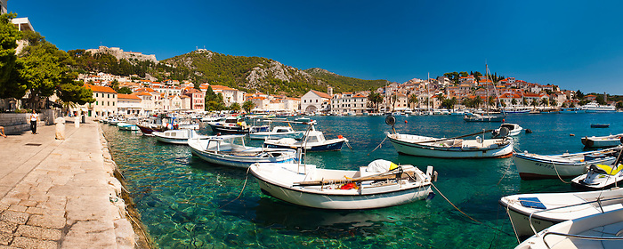 Panoramic photo of Hvar harbour, the Spanish Fortress and Hvar town centre, Hvar Island, Dalmatia, Croatia, Europe. This is a panoramic photo of Hvar harbour and Fortica, the Spanish Fortress in Hvar town centre.