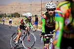 SULAIMANIYAH, IRAQ: Professional cyclist Nyan Yassin warms up before a race with other members of Newroz cycling club.<br /> <br /> Nyan Yassin, 24, is a professional competitive cyclist in Sulaimaniyah in the semi-autonomous region of Iraqi Kurdistan.  She is the captain of an all-female club called Newroz Club, which is the only cycling club for women in Sulaimaniyah, although there are other clubs around Iraq.  She trains and competes on roads that are badly surfaced and busy with traffic.<br /> <br /> Nyan was the first woman to start cycling in Sulaimaniyah.  She was always competitive and after trying her hand at different sports she settled on cycling.  She is now the top female cyclist in Iraq.  Her nickname is MigMig after the noise made by the cartoon character Roadrunner.<br /> <br /> Despite being clearly talented at her sport Nyan knows that in a couple of years she will have to get married and then abandon it as, in the traditional society that Kurdistan is, being a wife and a competitive sportswoman at the same time is not an option.<br /> <br /> Photo by Gona Hassan/Metrography