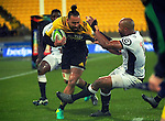Matt Proctor is scragged during the Super Rugby quarterfinal match between the Hurricanes and Sharks at Westpac Stadium, Wellington, New Zealand on Saturday, 23 July 2016. Photo: Dave Lintott / lintottphoto.co.nz