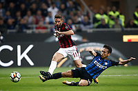 Calcio, Serie A: Milano, stadio Giuseppe Meazza, 15 ottobre 2017.<br /> Milan's Enrico Borini (l) in action with Inter's Yuto Nagatomo (r) during the Italian Serie A football match between Inter and Milan at Giuseppe Meazza (San Siro) stadium, October15, 2017.<br /> UPDATE IMAGES PRESS/Isabella Bonotto