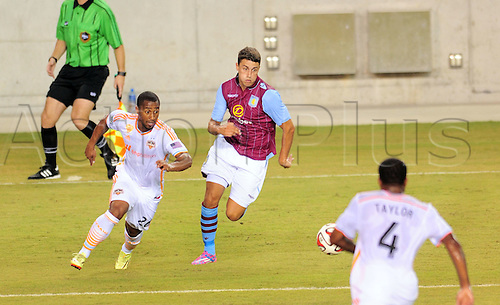 26.07.2014. Houston, Texas, USA.  Houston Dynmao  defender Corey Ashe(left) challenges Matthew Lowton for a loose ball during Houstons 1 - 0 loss to Aston Villa at BBVA Compass Stadium in Houston, TX.