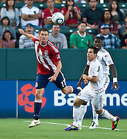 CARSON, CA – July 2, 2011: Chivas USA forward Justin Braun (17) and Chicago Fire midfielder Marco Pappa (16) during the match between Chivas USA and Chicago Fire at the Home Depot Center in Carson, California. Final score Chivas USA 1, Chicago Fire 1.