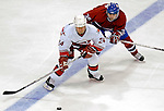 6 February 2007: Carolina Hurricanes right wing forward Scott Walker (24) battles Montreal Canadiens center Tomas Plekanec (35) of the Czech Republic maintaining possession of the puck at the Bell Centre in Montreal, Canada. The Hurricanes defeated the Canadiens 2-1.....Mandatory Photo Credit: Ed Wolfstein *** Editorial Sales through Icon Sports Media *** www.iconsportsmedia.com