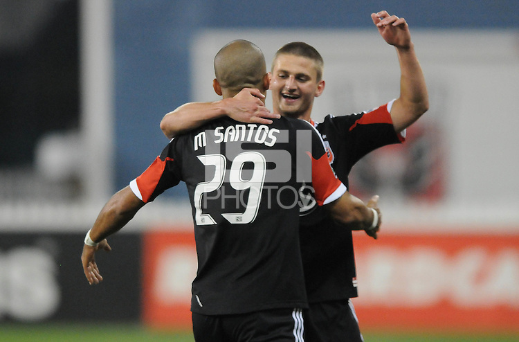 D.C. United forward Santos Maicon (29) celebrates his score with teammate Perry Kitchen (23) D.C. United tied The Montreal Impact 1-1, at RFK Stadium, Wednesday April 18 , 2012.