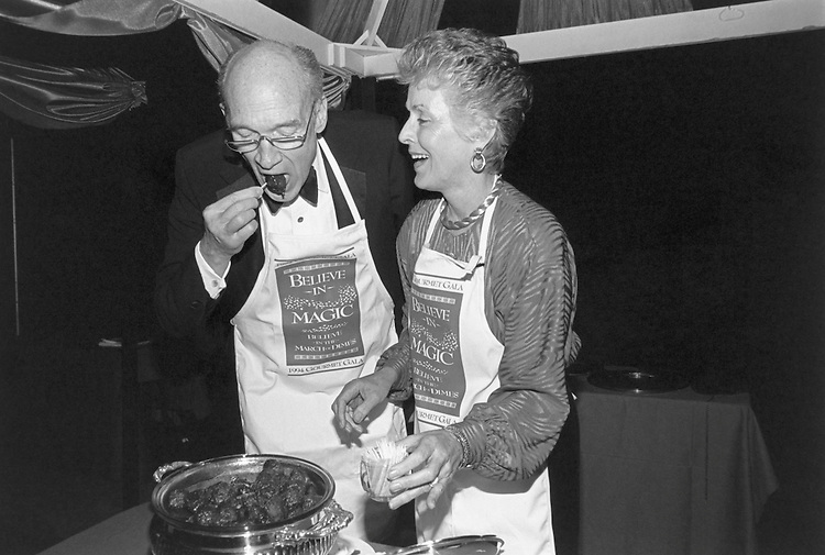 Sen. Alan K. Simpson, R-Wyo., And Ann Schroll at the Gourmet Gala night. Their specialty was venison meatballs carried back from Codie, WY on March 22, 1994. (Photo by Maureen Keating/CQ Roll Call)