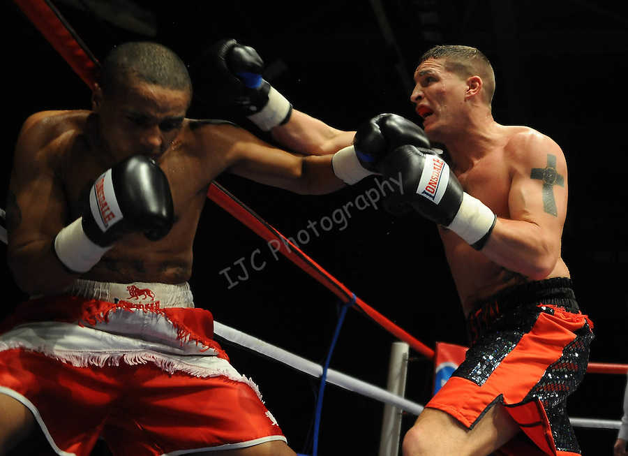 Justin Hugh (Black & Red shorts) V James Tucker (Red & White shorts). Joe Calzaghe Promotions Boxing Evening .Date: Friday 20/11/2009,  .© Ian Cook IJC Photography, 07599826381, iancook@ijcphotography.co.uk,  www.ijcphotography.co.uk, .