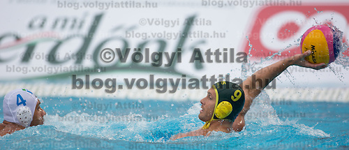 Pietro Figlioli (L) of Italy fights for the ball against Thomas Whalan (R) of Australia during the Vodafone Waterpolo Cup in Budapest, Hungary on July 15, 2012. ATTILA VOLGYI