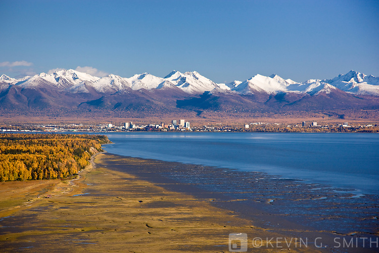 Aerial photo of the Anchorage Skyline, looking southeast from Point Mackenzie over Knik Arm with the Chugach Mountains in the background, Fall, Anchorage, Southcentral Alaska, USA.