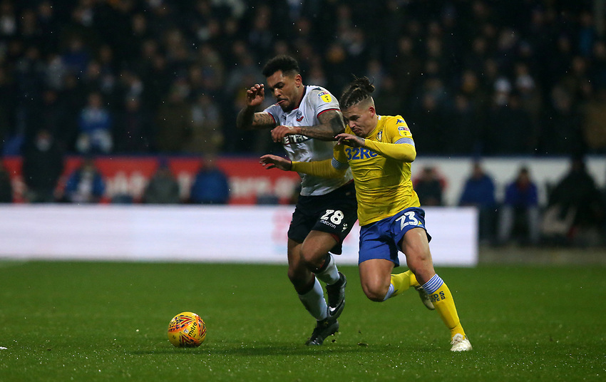 Leeds United's Kalvin Phillips and Bolton Wanderers' Josh Magennis<br /> <br /> Photographer Stephen White/CameraSport<br /> <br /> The EFL Sky Bet Championship - Bolton Wanderers v Leeds United - Saturday 15th December 2018 - University of Bolton Stadium - Bolton<br /> <br /> World Copyright © 2018 CameraSport. All rights reserved. 43 Linden Ave. Countesthorpe. Leicester. England. LE8 5PG - Tel: +44 (0) 116 277 4147 - admin@camerasport.com - www.camerasport.com