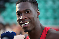 Tuesday 15th July 2014<br /> Pictured: Christian Malcolm<br /> RE: Welsh sprinter Christian Malcolm, smiling as he's interviewed by the media after competing in the 4x100m relay at the Welsh Athletics International in the Cardiff International Sports Stadium, South Wales, UK. His last race on home soil.