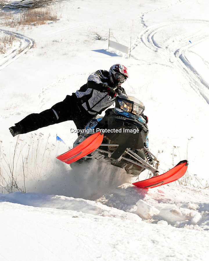 A rider struggles up the Caspian Ski Hill, Caspian, MI, during the 2013 MASTERS HIllclimb competition Saturday, Feb. 16.