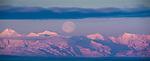 Moonset  and aplenglow over Alaska Range west of Anchorage, Alaska.