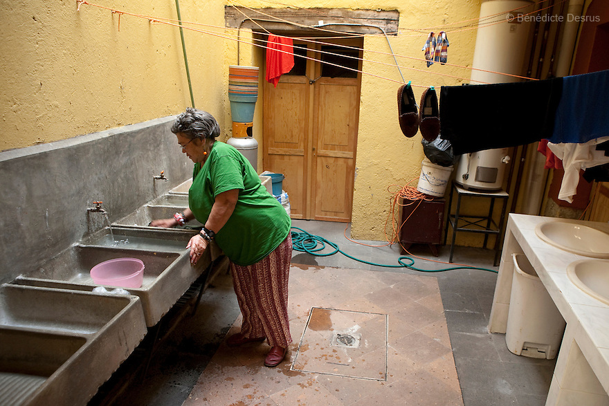 Raquel, a resident of Casa Xochiquetzal, does launsdry at the shelter in Mexico City, Mexico on March 4, 2008. Casa Xochiquetzal is a shelter for elderly sex workers in Mexico City. It gives the women refuge, food, health services, a space to learn about their human rights and courses to help them rediscover their self-confidence and deal with traumatic aspects of their lives. Casa Xochiquetzal provides a space to age with dignity for a group of vulnerable women who are often invisible to society at large. It is the only such shelter existing in Latin America. Photo by Bénédicte Desrus