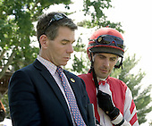 Trainer Neil Morris and jockey Chris Read plan strategy before the third at Fair Hill.