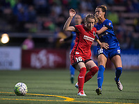 Seattle, WA - Saturday, May 14, 2016: Portland Thorns FC defender Emily Sonnett (16) and Seattle Reign FC defender Carson Pickett (16) collide during the second half. The Portland Thorns FC and the Seattle Reign FC played to a 1-1 tie during a regular season National Women's Soccer League (NWSL) match at Memorial Stadium.