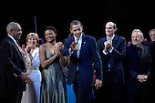 Washington, DC - March 8, 2009 -- United States President Barack Obama (C) joins performers (including host Bill Cosby (L) and James Taylor (2-R)) on stage to lead in singing 'Happy Birthday' to Senator Ted Kennedy (Democrat- Massachusetts)  at a musical tribute to celebrate Kennedy's birthday at the Kennedy Center in Washington, DC., USA, on Sunday, 08 March 2009.  .Credit: Chris Usher - Pool via CNP
