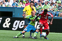 Fredy Ljungberg (L) of the Seattle Sounders fights for the ball against Amadou Sanyang (R) of Toronto FC in the match at the XBox Pitch at Quest Field on August 29, 2009. The Sounders and Toronto played to a 0-0 draw.