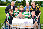 Mike Lyne, Killarney Celtic Football Club, pictured presenting a cheque for EUR6,835 to Fergus Finlay, Barnardos, after their U9 tournament held recently. Also pictured are Eugene Cosgrave, Evan and Peter Cosgrave, Peader Furlong, Mary Lyne, Eoin O'Donovan and Michael Herlihy.