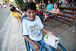 Duc lost both legs as a soldier in the South Vietnamese army during the Vietnam War. He now makes a living selling post cards in Nha Trang, Vietnam. July 9, 2011.