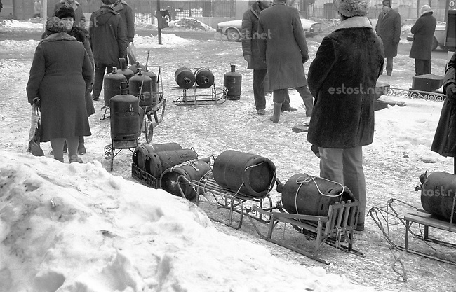 ROMANIA, Rosetti Street, Bucharest, 02.1985..Great expectations - queuing for gas cylinders, which have not arrived yet..© Andrei Pandele / EST&OST
