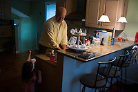 Fred Bermont gets ready for work at his home in Lexington, Massachusetts, USA, on June 9, 2014. Bermont is the father of two children and shares parenting duties with his wife, Jen Bermont. Fred usually takes care of the morning routine, including feeding, dressing, and dropping the kids off at day-care, and Jen picks them up and watches over them in the afternoon. Fred is a Senior Clinical Standards Specialist at Shire, a pharmaceutical company with headquarters in Lexington.