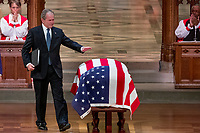 An emotional former President George Bush touches the flag-draped casket of his father, former President George H.W. Bush, after speaking during his State Funeral at the National Cathedral, Wednesday, Dec. 5, 2018, in Washington. <br /> CAP/MPI/RS<br /> &copy;RS/MPI/Capital Pictures