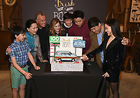 LOS ANGELES - FEBRUARY 27: In honor of Fresh Off the Boat's 100th episode cast members Randall Park, Constance Wu, Hudson Yang, Ian Chen, Forrest Wheeler, Lucille Soong, Chelsea Crisp and Ray Wise celebrated with an elaborate cake-cutting and champagne toast on Stage 88 on the Fox Lot on Wednesday afternoon. (Photo by Frank Micelotta/TCFTV/PictureGroup)