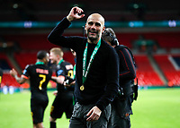 1st March 2020; Wembley Stadium, London, England; Carabao Cup Final, League Cup, Aston Villa versus Manchester City; Manchester City Manager Pep Guardiola celebrating with a winners medal towards the Manchester City fans