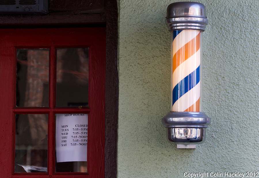 CLIPPED HOURS ON THURSDAY: Like most businesses in Monticello, Register's Barbershop follows the town tradition of closing at noon on Thursday...COLIN HACKLEY PHOTO
