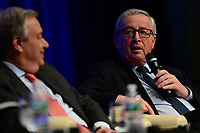 "Washington, DC - April 21, 2017: European Commission President Jean-Claude Juncker speaks at the""Financing for Peace"" panel discussion during the annual Spring Meetings of the IMF/World Bank Group at the IMF headquarters in the District of Columbia April 21, 2017, as United Nations Secretary General Antonio Guterres looks on. (Photo by Don Baxter/Media Images International)"