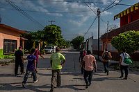 ARRIAGA, MEXICO - NOVEMBER 08: Migrants walk along the street as they start walking in Arriaga on their way to Chahuites and El Camino north on the 8th of November, 2015 in Arriaga, Mexico. <br /> <br /> Daniel Berehulak for The New York Times