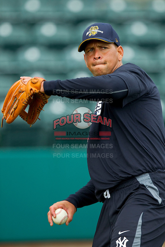Alex Rodriguez #13 of the New York Yankees plays catch prior to taking some ground balls at Joseph P. Riley Park on July 2, 2013 in Charleston, South Carolina.  Rodriguez began a rehab stint with the Charleston RiverDogs, the South Atlantic League affiliate of the New York Yankees.   (Brian Westerholt/Four Seam Images)