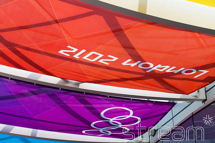 London 2012 pavilion covers with the words london 2012 and the olympic logo on red and purple material.