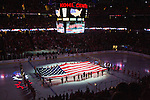A general view of the Kohl Center during the National Anthem prior to the Wisconsin Badgers NCAA college women's hockey game against the Minnesota Golden Gophers Saturday, February 15, 2014 in Madison, Wis. The Golden Gophers won 4-0. (Photo by David Stluka)