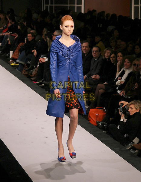 MODEL.Ungaro Ready to Wear Autumn/Winter Fashion Show Collection 2005/2006, Paris, France, March 1st 2005..full length runway catwalk blue coat.**UK SALES ONLY**.Ref: MDS.www.capitalpictures.com.sales@capitalpictures.com.©Virgille Biechy/O.Medias/Capital Pictures .