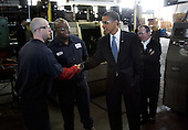 Bedford Heights, OH - January 16, 2009 -- United States President Elect Barack Obama (C) greets workers at Cardinal Fastener & Specialty Company, Inc., in Bedford Heights, Ohio, USA, 16 January 2009.  Obama met with workers at the plant, which manufactures parts used to construct wind turbines, to discuss an American Recovery and Reinvestment Plan, which would aim to create nearly half a million American jobs by investing in clean energy.  .Credit: David Maxwell - Pool via CNP