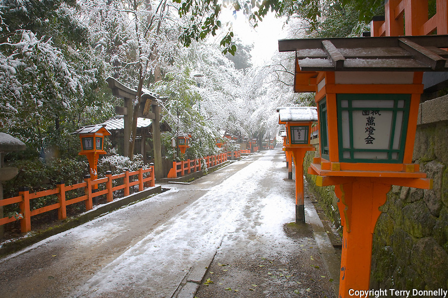 Kyoto City, Japan<br /> Yasaka Shrine, Gion district, snowy pathway in falling snow