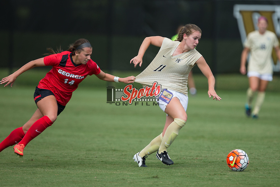 Sydney Shultis (14) of the Georgia Bulldogs pulls on the jersey of Maddie Huster (11) of the Wake Forest Demon Deacons to try and keep her from moving the ball up the field at Spry Soccer Stadium on August 23, 2015 in Winston-Salem, North Carolina.  The Deacons defeated the Bulldogs 4-0.   (Brian Westerholt/Sports On Film)