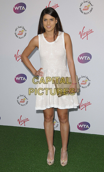 Sorana Cirstea.The WTA Pre-Wimbledon Party, The Roof Gardens, Kensington High St., London, England..June 21st, 2012.full length white dress sleeveless beige clutch bag hand on hip.CAP/CAN.©Can Nguyen/Capital Pictures.