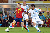 16.06.2013 Recife, Brazil. Andres Iniesta against Walter Gargano during the Confederations Cup Group B game between Spain and Uruguay from Arena Pernambuco.
