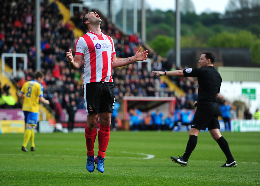 Lincoln City's Matt Rhead reacts after missing a chance in the first half<br /> <br /> Photographer Chris Vaughan/CameraSport<br /> <br /> Vanarama National League - Lincoln City v Torquay United - Friday 14th April 2016  - Sincil Bank - Lincoln<br /> <br /> World Copyright &copy; 2017 CameraSport. All rights reserved. 43 Linden Ave. Countesthorpe. Leicester. England. LE8 5PG - Tel: +44 (0) 116 277 4147 - admin@camerasport.com - www.camerasport.com