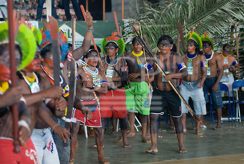 "Altamira, Brazil. ""Xingu Vivo Para Sempre"" protest meeting about the proposed Belo Monte hydroeletric dam and other dams on the Xingu river and its tributaries. Kayapo  dance in protest."