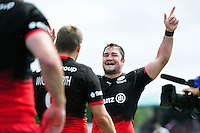 Brad Barritt of Saracens celebrates a try by team-mate Chris Wyles in the second half. Aviva Premiership semi final, between Saracens and Leicester Tigers on May 21, 2016 at Allianz Park in London, England. Photo by: Patrick Khachfe / JMP