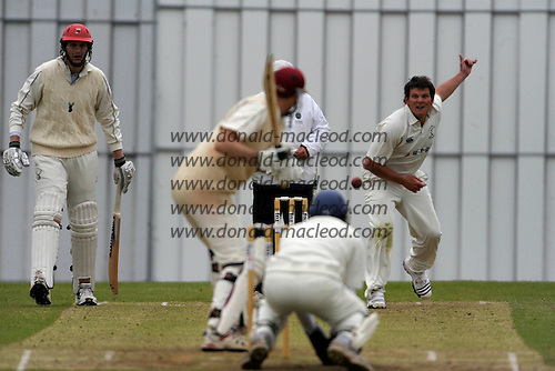 Scottish National Cricket League, Premier Division, Grange CC V Carlton CC at Raeburn Place, Edinburgh - Saltire's and Carlton bowler Gordon Drummond bowls past Grange pro Allan Wise, and umpire Sandy Scotland, to batsman Stuart Davidson - Picture by Donald MacLeod - 23 May 2009