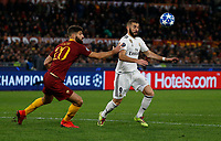 Karim Benzema of Real Madrid  and Federico Fazio of AS Roma  during the Champions League Group  soccer match between AS Roma - Real Madrid  at the Stadio Olimpico in Rome Italy 27 November 2018