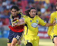 Columbus Crew Defender Gino Padula (4) and Real Salt Lake Forward Fabian Espindola (16) in the Real Salt Lake 1-0 win over Columbus Crew in Game 1 of the Semi-Finals of the MLS Playoffs on October 31, 2009 at  Rio Tinto Stadium in Sandy, Utah