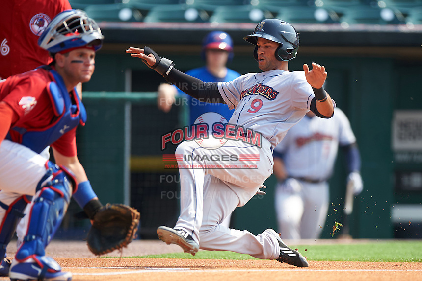 Scranton/Wilkes-Barre RailRiders outfielder Mason Williams (9) slides home safely past catcher Sean Ochinko (9) during a game against the Buffalo Bisons on June 10, 2015 at Coca-Cola Field in Buffalo, New York.  Scranton/Wilkes-Barre defeated Buffalo 7-2.  (Mike Janes/Four Seam Images)