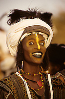 Akadaney, Niger, Africa - Fulani Wodaabe Dancer at Geerewol. A participant in what westerners often call the male beauty contest, in which the whiteness of the eyes and the teeth is an important factor in appealing to the female spectators.